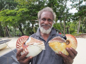 Chief Peter holding the two nautiluses, Nautilus and Allonautilus, and seeing them alive for the first time. Chief Peter was instrumental in allowing our group to conduct the research in their waters and helping us every step of the way. (Photo by Peter Ward)