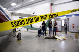 The district's new aviation technology facility was the crime scene for the Central Campus criminal justice class.