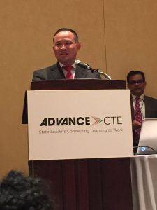 Central Campus Assistant Director Aiddy Phomvisay makes remarks during Advance CTE's presentation of the 2016 Excellence in Action Award for Hospitality & Tourism Career Cluster to Culinary Arts & Restaurant Management Academy