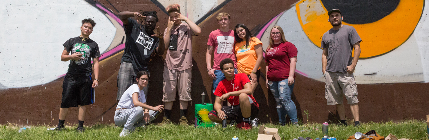 Central Campus Students Working on Graffiti Wall